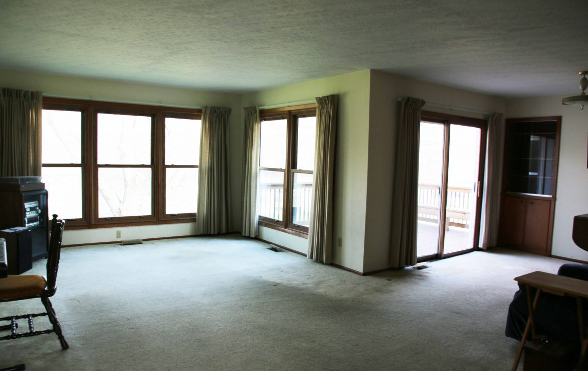 Main level living area with new windows that allows an abundance of natural light to fill the room.  Windows drop/fold down for easy cleaning and maintance.