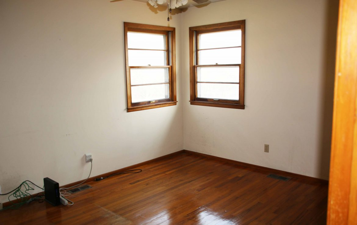 Main level bedrooms all have original wood floors. Master has mater bath.